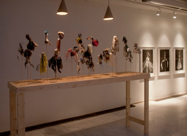 Installation. Mixed techniques, 80 puppets made out of flotsam, 3 tables on size 120 x 240 x 60cm